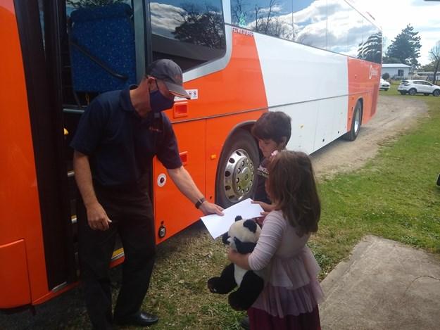 Busways driver Warwik Jones with students Felix and Ameilia.jpg