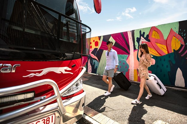 Tourists boarding Greyhound coach.jpg