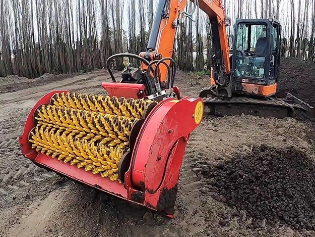Four- to nine-tonne bucket, processing 18mm clay based topsoil