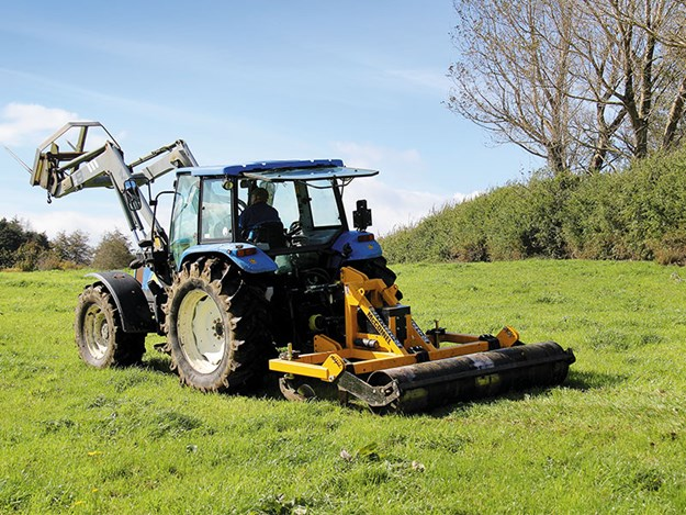 The McConnel Shakeaerator towed behind a New Holland tractor