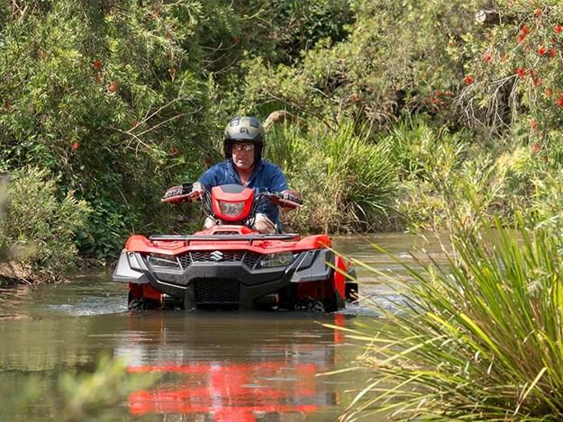 Suzuki 500AXi Kingquad working through the water