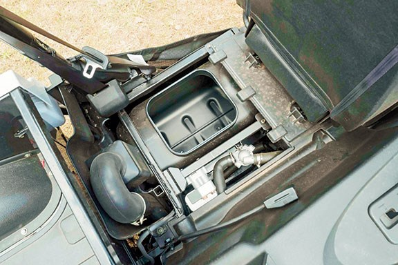 Sliding the driver's seat forward gives access to a handy storage bin.