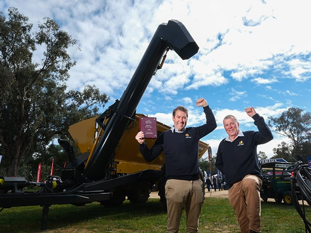 Heath and Bruce Hutcheon, Coolamon, celebrate the Henty Machine of the Year Award for the Coolamon Spreader Chaser