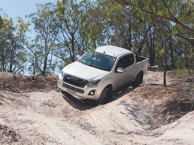 An Isuzu D-Max driving through sand