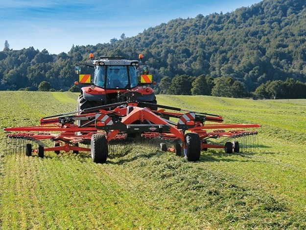 The Kuhn GA8731 being pulled by a Massey Ferguson tractor