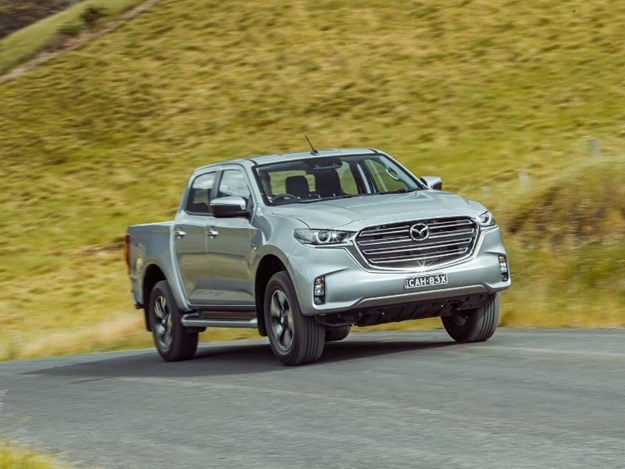 The new Mazda BT-50 driving along a country road
