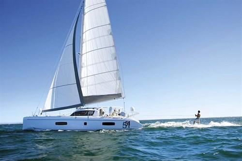 Wakeboarding behind sailboat