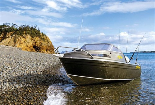 Beached Fyran 550 boat