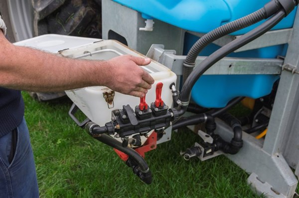 The Two Red Levers activate hopper rinse and dry chemical mixing