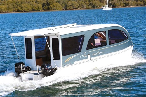 Caraboat 7500 caravan house boat on the water