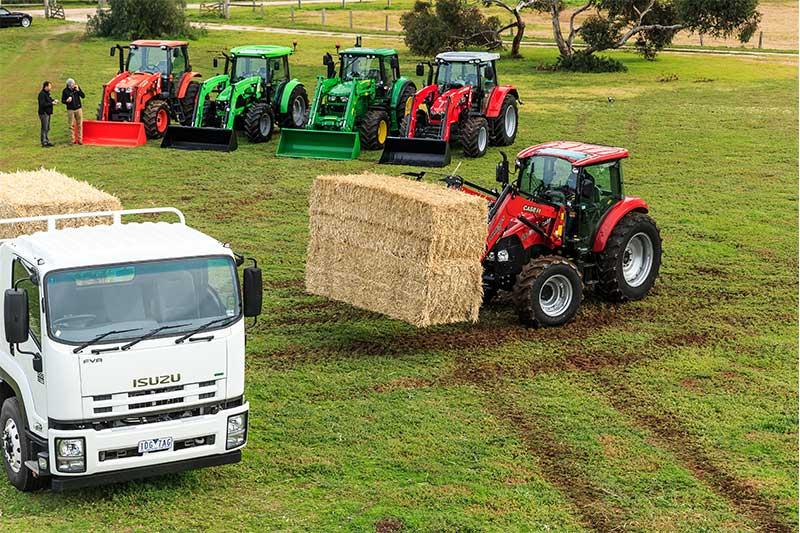 Case IH Farmall 95C tractor lifting hay