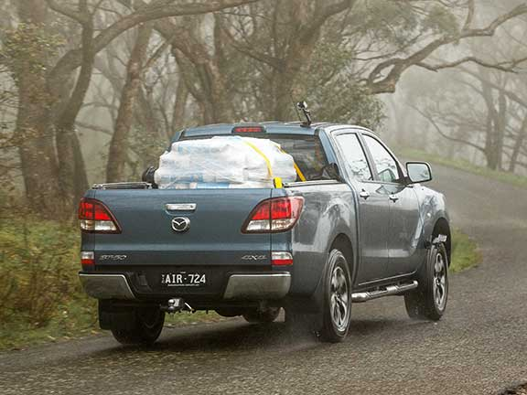 Mazda BT-50 ute carrying load uphill