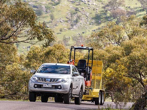 Mitsubishi Triton ute towing trailer