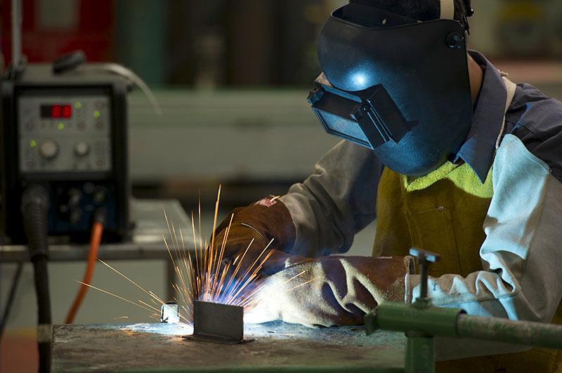 Worker using an inverter welder