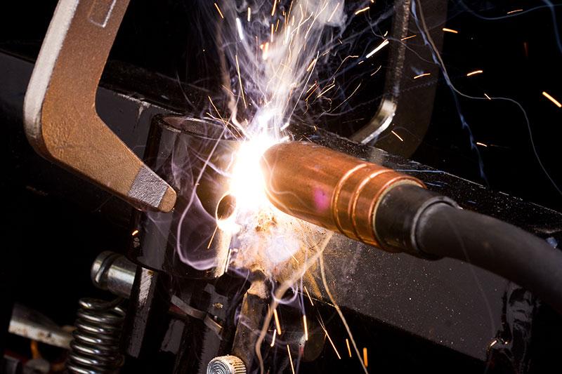 Worker uses a MIG welder