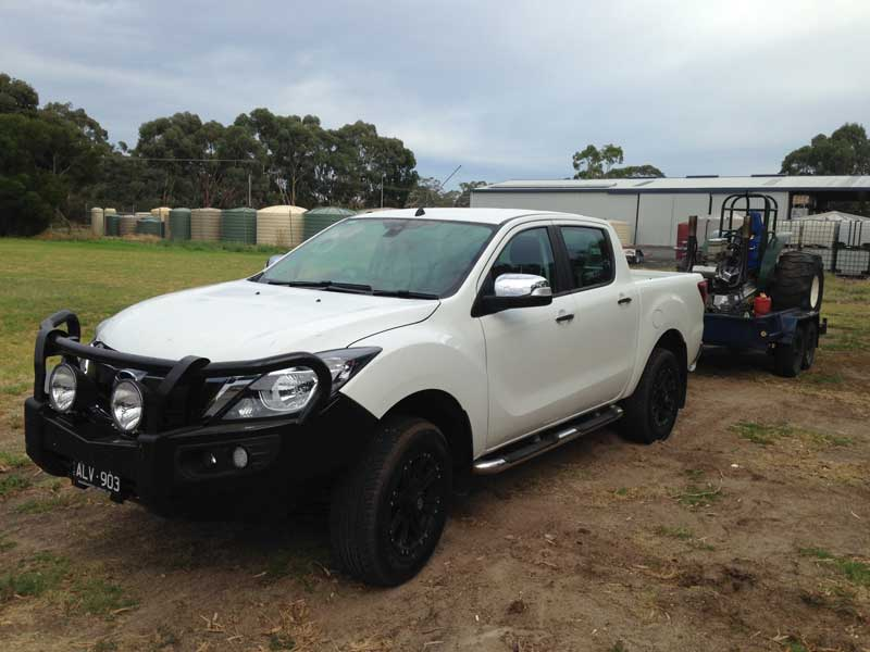Mazda BT50 with tractor and trailer