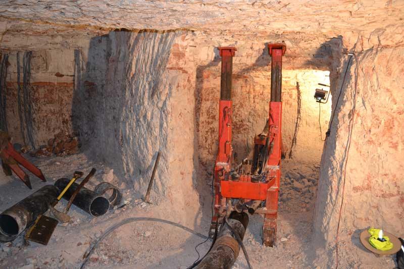 Underground mining backhoe arm