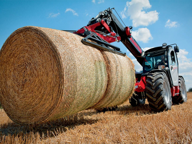 Manitou MLT NewAg telehandler with hay bale