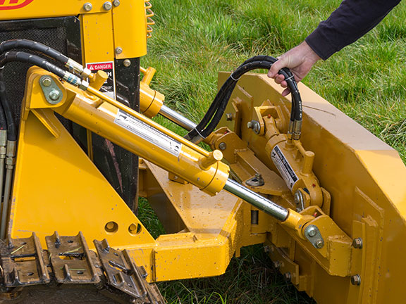Hydraulic rams provide lift, tilt and angle to the 1.8m blade