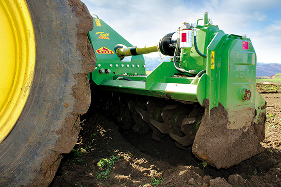 The Celli tiger rotary hoe behind a John Deeere 8235R