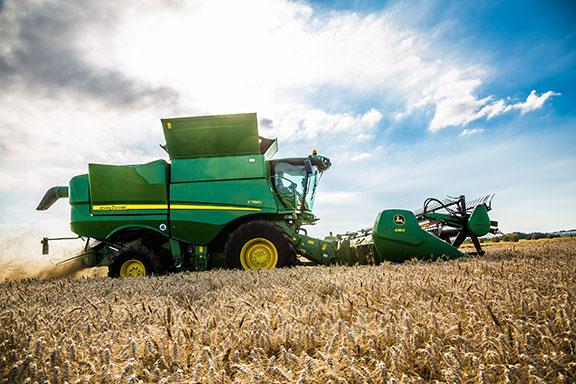 The John Deere s790 combine harvester working a field