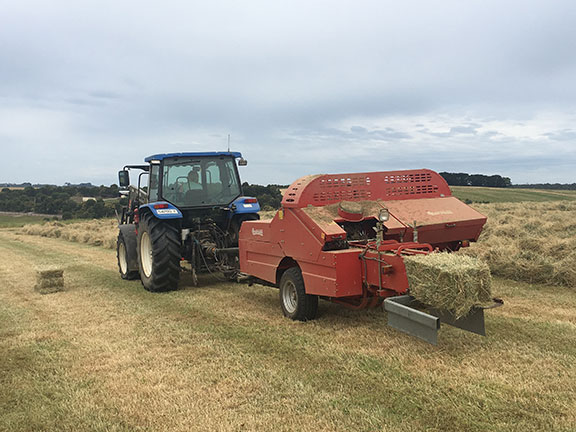 Another perfectly shaped and weighted bale exits the Enorossi Enopack 900's bale chamber