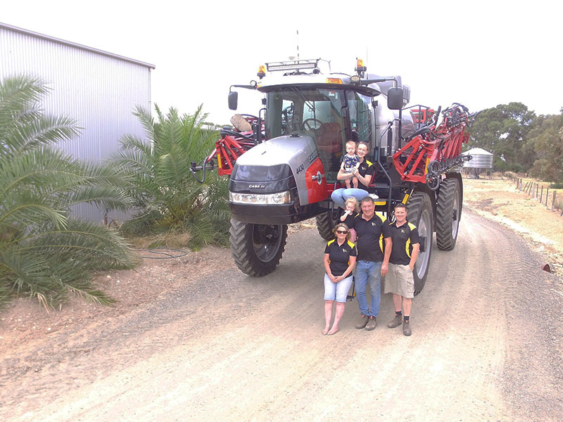 The Krieg family with their hardworking, special anniversary Patriot sprayer. Clockwise from top, Caitlin, Josh, Robin and Robyn, and Caitlin and Josh's children Ellie and Noah