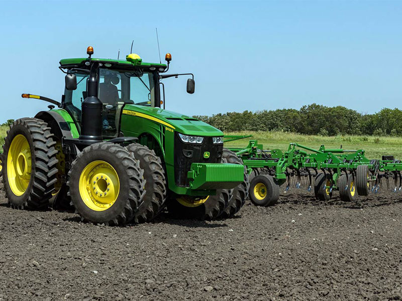 John Deere tractor showing off its AutoTrac turn automation technology width=