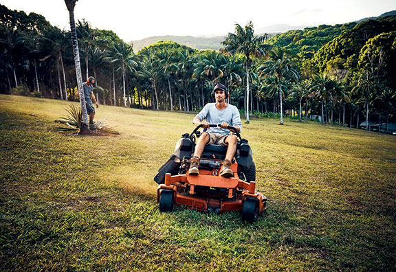 Mowing the paddocks with a zero-turn mower