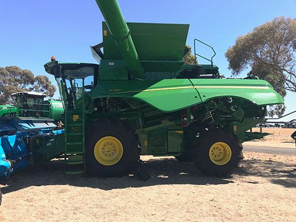John Deere S780 combine harvester side on