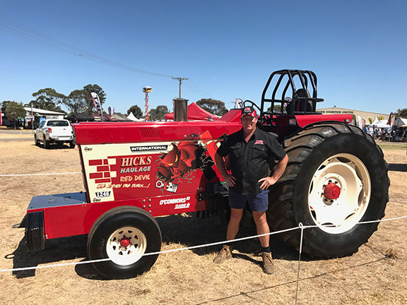 Chris Hicks poses with the Red Devil at the Wimmera field days