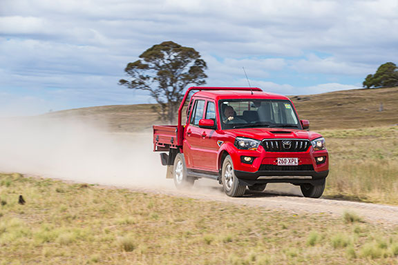 The Mahindra Pik-Up driving on the road
